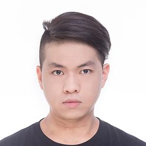 Dan Wang in a black t-shirt.